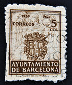 SPAIN - CIRCA 1944: A stamp printed in Spain shows Stamp commemorating the council Barcelona, 1939-1944, Barcelona ancient shield with two sticks of gules, the cross of St. George and the crown. circ — Stock Photo