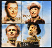 FINLAND - CIRCA 1999: collection stamps printed in Finland shows various artists: Olavi Virta-singer, Georg Halmsten-composer, Tapio Raulavaara-singer and Esa Parkatinan-musician,actor, circa 1999 — Foto Stock
