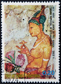 EQUATORIAL GUINEA - CIRCA 1974: A stamp printed in Equatorial Guinea dedicated to the female nude in art history shows the golden-skinned young of Indian art, circa 1974 — Stock Photo