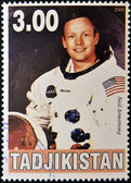 TAJIKISTAN - CIRCA 2000: A stamp printed in Tajikistan shows Neil Armstrong, circa 2000 — Stock Photo