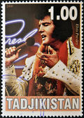 TAJIKISTAN - CIRCA 2000: A stamp printed in Tajikistan shows Elvis Presley, circa 2000 — Stock Photo