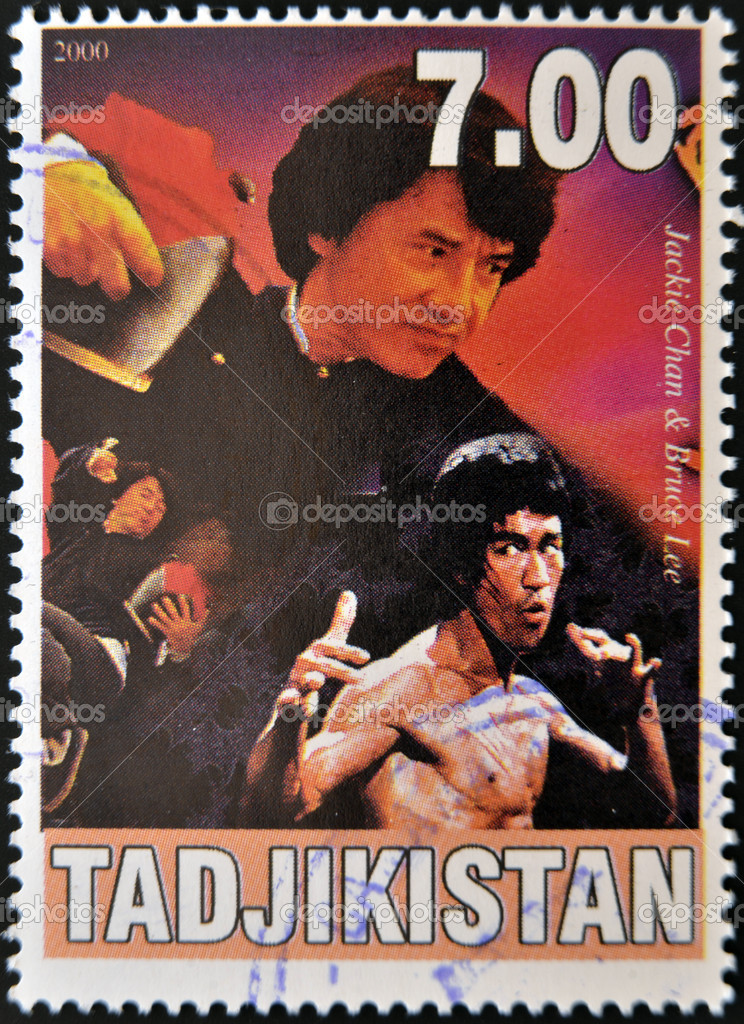 TAJIKISTAN - CIRCA 2000: A stamp printed in Tajikistan shows Bruce Lee and Jackie Chan, circa 2000 — Stock Photo #11755817