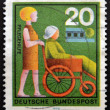 GERMANY - CIRCA 1970: a stamp printed in Germany shows woman Assisting Elderly Woman, circa 1970 — Stock Photo