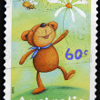 AUSTRALI- CIRC2010: stamp printed in Australishows bear with blue scarf on neck, daisy and bee, circ2010 — Stockfoto #11844224
