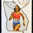 CUBA - CIRCA 1995: A stamp printed in Cuba dedicated to Olympic Games in Atlanta 1996, shows running, circa 1995 — Stock Photo