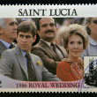 SAINT LUCIA - CIRCA 1986: A stamp printed in Saint Lucia shows a portrait of Prince Andrew of England and Nancy Reagan watching a parade, the royal wedding commemorative, circa 1986 — Stock Photo #11844621
