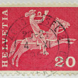Stock Photo: SWITZERLAND - CIRC1970: stamp printed in Switzerland shows horsemblowing horn, circ1970
