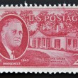 UNITED STATES OF AMERICA - CIRCA 1945: Stamp printed in USA shows Franklin Delano Roosevelt and little White House, circa 1945 — Stock Photo