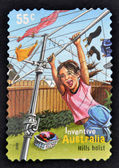 AUSTRALIA - CIRCA 2009: A stamp printed in Australia shows a girl playing on a clothesline as a hills hoist, inventive, circa 2009 — Stock Photo