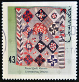 CANADA - CIRCA 1993: A stamp printed in Canada shows Pieced quilt, Ontario, circa 1993 — Stock Photo