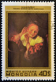 MONGOLIA - CIRCA 1981: stamp printed in Mongolia shows Young Woman with Earrings by Rembrandt, circa 1981 — Stock Photo