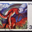 Stock Photo: GERMANY- CIRC1974: stamp printed in Germany, shows Deer in red by Franz Marc, circ1974.