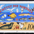 Royalty-Free Stock Photo: GERMANY - CIRCA 1990: A stamp printed in Germany dedicated to Nature and Environmental Protection, shows the flora and fauna of the North Sea, circa 1990