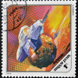 HUNGARY - CIRCA 1978: A stamp printed in Hungary shows a futuristic space ship around Phobos, the Martian moon, circa 1978. — Stock Photo #11969692