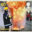 Foto Stock: UNITED KINGDOM - CIRCA 2009: a stamp printed in UK shows a firefighter putting out a fire, fire safety, circa 2009