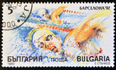 BULGARIA - CIRCA 1990: stamp printed in Bulgaria, shows swimming, circa 1990. — Stockfoto