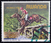 RWANDA - CIRCA 1984: A stamp printed in Rwanda shows stadium jumping, circa 1984 — Stock Photo