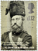 UNITED KINGDOM - CIRCA 2004: a stamp printed in UK shows a portrait of Sergeant Glasgow who participated in the Crimean War, circa 2004 — Stock Photo