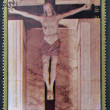 AJMAN - CIRCA 1972: A stamp printed in Ajman, Christmas collection, peace in the world, shows a sculpture of the crucifixion of Christ Della Robbia work , circa 1972 — Stock Photo