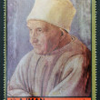 AJMAN - CIRCA 1972: A stamp printed in Ajman Christmas collection, peace in the world, shows portrait of an old man painted by Lippi, circa 1972 — Stock Photo