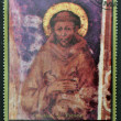 AJMAN - CIRCA 1972: A stamp printed in Ajman Christmas collection, peace in the world , shows St. Francis painted by Cimabue , circa 1972 — Stock Photo
