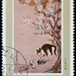 "DPR KOREA - CIRCA 1978: A stamp printed in North Korea shows draw by artist Ame Lee ""Kitten and Puppy"", circa 1978. — Stock Photo"
