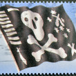 UNITED KINGDOM - CIRCA 2001: A stamp printed in Great Britain shows crossbones or Jolly Roger, circa 2001 — Stock Photo