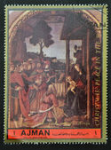 AJMAN - CIRCA 1972: A stamp printed in Ajman Christmas collection, peace in the world, shows the Adoration of the Magi painted by Perugino , circa 1972 — Stock Photo
