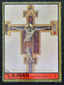 AJMAN - CIRCA 1972: A stamp printed in Ajman, Christmas collection, peace in the world, shows a painting of the crucifixion of Christ by the Master gave St. Francis , circa 1972 — Stock Photo