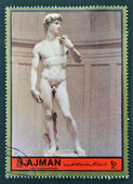 AJMAN - CIRCA 1972: A stamp printed in Ajman Christmas collection, peace in the world, shows the sculpture of David made by Michelangelo , circa 1972 — Stock Photo