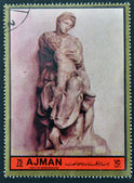 AJMAN - CIRCA 1972: A stamp printed in Ajman Christmas collection, peace in the world, shows the sculpture of The Virgin and The Baby, made by Michelangelo , circa 1972 — Stock Photo