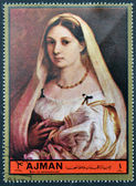 AJMAN - CIRCA 1972: A stamp printed in Ajman Christmas collection, peace in the world,shows portrait of an young lady painted by Raphael, circa 1972 — Stock Photo
