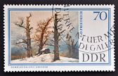 GERMANY - CIRCA 1967: A stamp printed in Easter Germany shows Dolmen in snow by Caspar David Friedrich, circa 1967 — Foto Stock