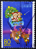 JAPAN - CIRCA 1999: A stamp printed in Japan, shows children in a sleigh of Santa Claus, circa 1999 — Stockfoto