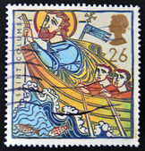 UNITED KINGDOM - CIRCA 1997: A stamp printed in Great Britain shows St Columba in Boat, circa 1997 — Stock Photo