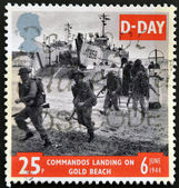 UNITED KINGDOM - CIRCA 1994: a stamp printed in Great Britain shows image of soldiers on Gold Beach in Normandy, commemorating D-Day, circa 1994 — Stock Photo