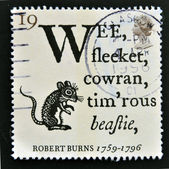UNITED KINGDOM - CIRCA 1996: A stamp printed in Great Britain shows Opening Lines of 'To a Mouse' and Field Mouse, Robert Burns, circa 1996 — Stock Photo