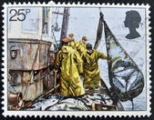 UNITED KINGDOM - CIRCA 1981: A stamp printed in Great Britain shows Hoisting Seine Net, fishing, circa 1981 — Stock Photo