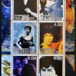 Стоковое фото: TAJIKISTAN - CIRC2001: Collection stamps printed in Tajikistshows Bruce Lee, circ2001