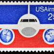 UNITED STATES OF AMERICA - CIRCA 1976: A stamp printed in USA showing a Boeing 737 airliner with background of U.S. flag, circa 1976. — Stock Photo