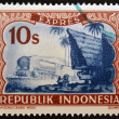 "INDONESIA- CIRC1947: stamp printed in Indonesishows locomotive and batak house, with inscription ""Expres"", circ1947 — 图库照片 #12365726"