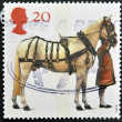 Royalty-Free Stock Photo: UNITED KINGDOM - CIRCA 1997: A stamp printed in Great Britain shows Carriage Horse and Coachman, circa 1997