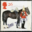 Stock Photo: UNITED KINGDOM - CIRC1997: stamp printed in Great Britain shows Lifeguards Horse and Trooper, circ1997