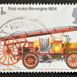 Stock Photo: UNITED KINGDOM - CIRC1974: stamp printed in Great Britain shows First Motor Fire engine, 1904, circ1974