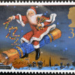 UNITED KINGDOM - CIRCA 1997: A stamp printed in Great Britain shows Father Christmas riding Cracker, circa 1997 — Stock Photo