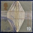 Foto Stock: UNITED KINGDOM - CIRC1999: stamp printed in Great Britain shows Woven Threads (woolen industry), circ1999