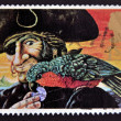 UNITED KINGDOM - CIRCA 1993: A stamp printed in Great Britain shows Long John Silver and Parrot (Treasure Island), circa 1993 - Foto de Stock