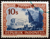 "INDONESIA- CIRCA 1947: A stamp printed in Indonesia shows a locomotive and batak house, with inscription ""Expres"", circa 1947 — Stock Photo"