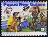 PAPUA NEW GUINEA - CIRCA 1995: A stamp printed in Papua dedicated to tourism shows handcrafts, circa 1995 — Stok fotoğraf