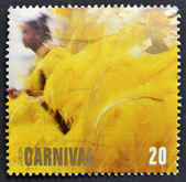 UNITED KINGDOM - CIRCA 1998: A stamp printed in Great Britain shows Woman in Yellow Feathered Costume, Carnival (Europa), circa 1998 — Stock Photo